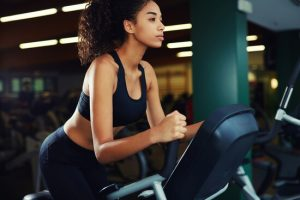 woman using stationary bike