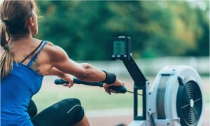 girl using a rowing machine outdoor