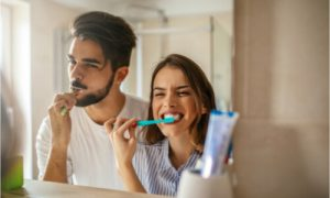 The couple uses the best toothpaste for gum disease.