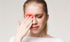 The girl experiences severe eye pain from trauma